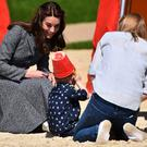 "Kate Middleton tours the ""Magic Garden"" children's play area at Hampton Court Palace/ AFP / BEN STANSALL"