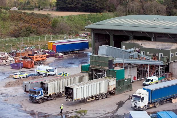 Garda forensics examine the site at the Greenstar recycling facility in Fassaroe, Bray, Co. Wicklow where 'remains' were found. Photo: Tony Gavin