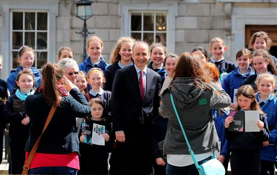 Fianna Fáil leader Micheál Martin with pupils from St Joseph's Primary School in Macroom, Co Cork, who were visiting Leinster House before the deal with Fine Gael was announced on Tuesday evening Photo: Tom Burke