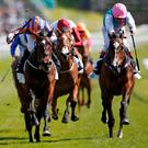 Somehow and Ryan Moore (left) get the better of second-placed Moorside in the Cheshire Oaks. Photo: Alan Crowhurst/Getty Images