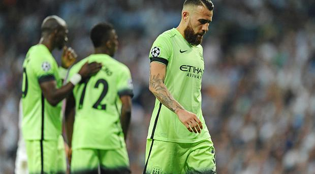 MADRID, SPAIN - MAY 04: Nicolas Otamendi of Manchester City looks dejected during the UEFA Champions League semi final, second leg match between Real Madrid and Manchester City FC at Estadio Santiago Bernabeu on May 4, 2016 in Madrid, Spain. (Photo by David Ramos/Getty Images )