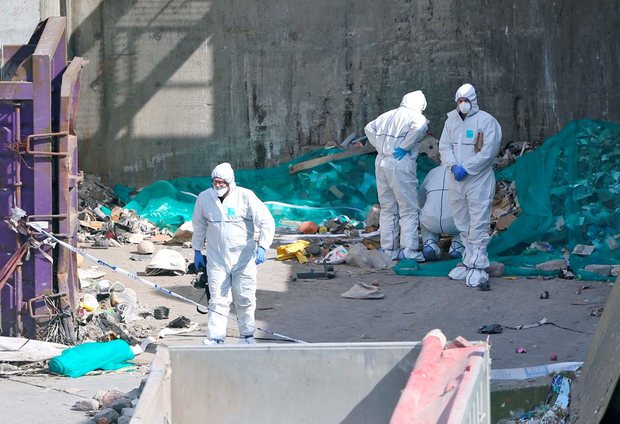 Garda forensic officers examine the site at the Greenstar recycling facility in Bray, Co Wicklow where the baby was found Photo: Colin Keegan, Collins Dublin