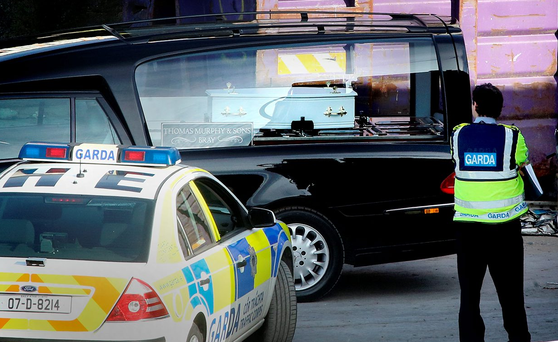 A hearse takes away the remains of the baby Photo: Gerry Mooney
