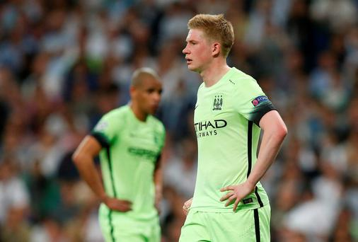 Manchester City's Fernando and Kevin De Bruyne look dejected after their Champions League exit at the hands of Real Madrid