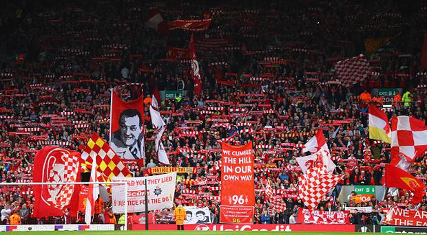 LIVERPOOL, UNITED KINGDOM - MAY 05: Banners and flags are waved on The Kop prior to the UEFA Europa League semi final second leg match between Liverpool and Villarreal CF at Anfield on May 5, 2016 in Liverpool, England. (Photo by Richard Heathcote/Getty Images)
