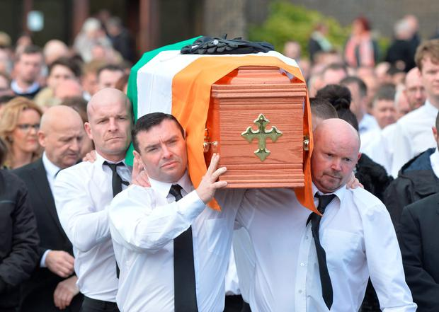 Michael Barr's coffin is draped in the Tricolour at the funeral in Strabane.