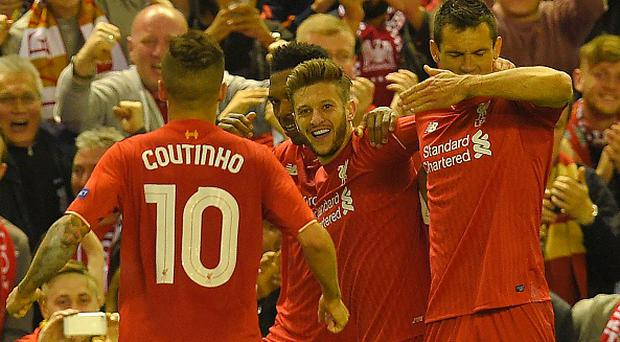 Liverpool's English midfielder Adam Lallana (C) celebrates after scoring his team's third goal during the UEFA Europa League semi-final second leg football match between Liverpool and Villarreal CF at Anfield in Liverpool, northwest England on May 5, 2016. / AFP / LLUIS GENE (Photo credit should read LLUIS GENE/AFP/Getty Images)