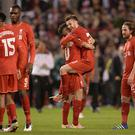 Liverpool's English midfielder Adam Lallana (3rd R) celebrates at the final whistle after a 3-0 victory during the UEFA Europa League semi-final second leg football match between Liverpool and Villarreal CF at Anfield in Liverpool, northwest England on May 5, 2016. / AFP / OLI SCARFF (Photo credit should read OLI SCARFF/AFP/Getty Images)
