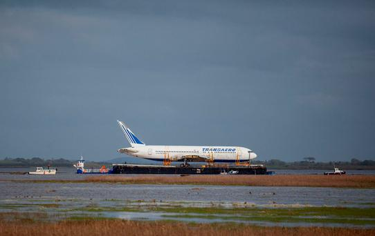 The Boeing 767 is seen atop a barge as it makes its journey up the Shannon Estuary. Photo: Fusionshooters