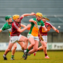 Paddy Rigney (left) and Pat Camon give it their all as they battle it out with Westmeath's Darragh Egerton during the Leinster SHC match in Mullingar (SPORTSFILE)
