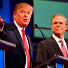 Donald Trump appears on stage with Jeb Bush during a Republican debate in the early stages of the campaign in August 2015. Below: George W Bush. Photo: AP