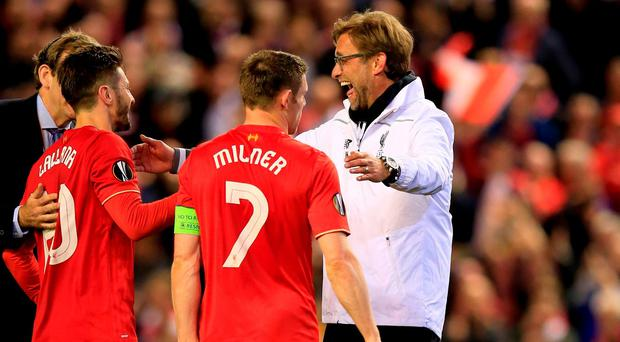 Liverpool manager Juergen Klopp, right, with James Milner and Adam Lallana Photo: AP
