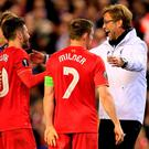 Liverpool manager Juergen Klopp, right, celebrates with James Milner and Adam Lallana Photo: AP