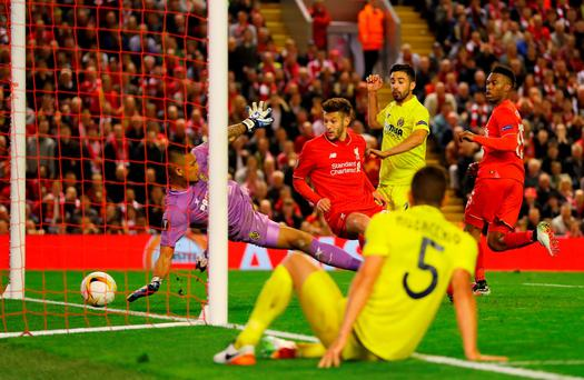Adam Lallana (C) scores Liverpool's third goal against Villarreal during last night's Europa League semi-final second leg at Anfield Photo: Getty