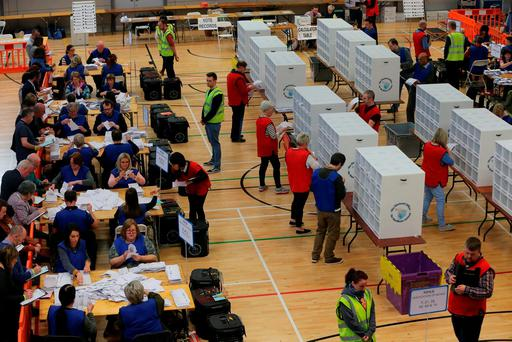 Counting of votes continues at the Foyle Arena in Derry. Photo: Niall Carson/PA Wire