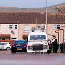 Police officers arriving to the scene of a shooting in the Distillery Court area of west Belfast. Photo by Kevin Scott / Belfast Telegraph