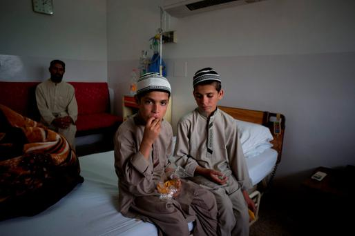 Pakistani children Abdul Rasheed (9) left, and Shoaib Ahmed (13) AP Photo/B.K. Bangash