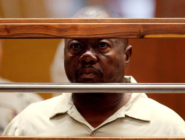 Lonnie David Franklin Jr. stands in court during his arraignment on 10 counts of murder and one count of attempted murder in Los Angeles Criminal Court, in Los Angeles, California, U.S. in this July 8, 2010 file photo. REUTERS/Al Seib/Pool/File Photo