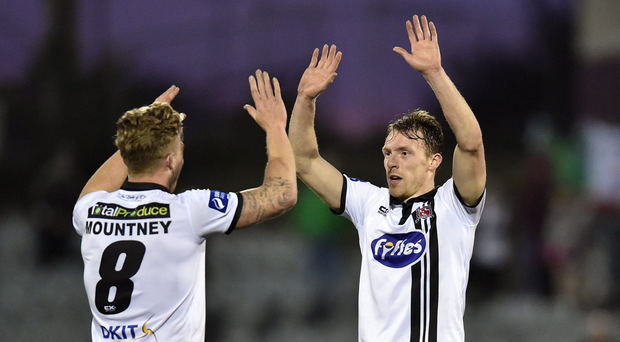 David McMillan celebrates with team-mate John Mountney after scoring his side's second goal (SPORTSFILE)