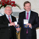 Taoiseach Enda Kenny receives his seal of office from President Michael D Higgins at Áras an Uachtaráin Photo: Kyran O'Brien