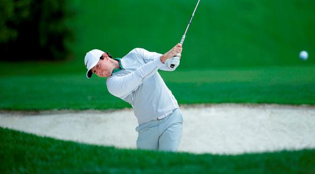 Rory McIlroy plays his second shot out of a fairway bunker on the fourth hole during the second round of the Wells Fargo Championship at Quail Hollow yesterday. Photo: Jeff Gross/Getty Images