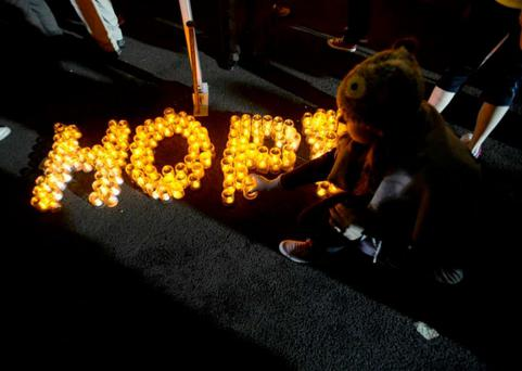 Candles spell out the message of the Darkness into Light event in Malahide - HOPE.