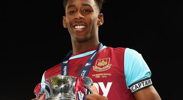 Reece Oxford celebrates leading West Ham to Under-21s Cup glory Getty