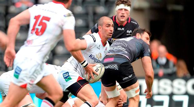 Ruan Pienaar, Ulster, looks to get the ball away. Guinness PRO12, Round 22, Ospreys v Ulster. Liberty Stadium, Swansea, Wales. Picture credit: Ben Evans / SPORTSFILE
