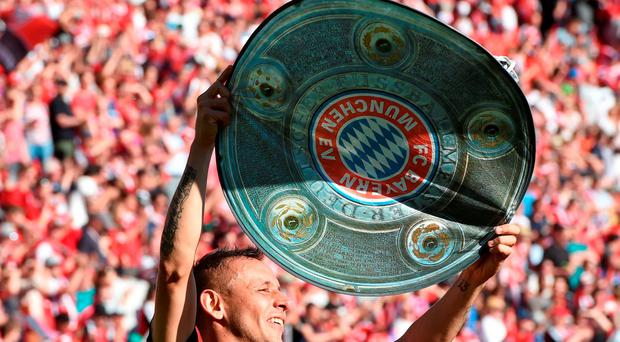 Bayern Munich's Brazilian defender Rafinha celebrates with a paper mock up of the Bundesliga trophy after the German first division Bundesliga football match between FC Ingolstadt 04 and FC Bayern Munich, at the Audi Sportpark in Ingolstadt