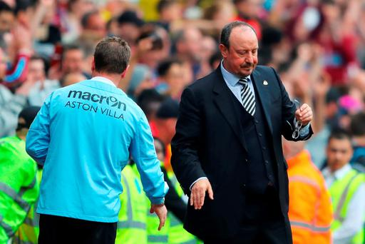 Eric Black, acting manager of Aston Villa and Rafael Benitez manager of Newcastle United shake hands after their team's scoreless draw in the Barclays Premier League match between Aston Villa and Newcastle United at Villa Park