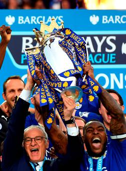 Captain Wes Morgan and manager Claudio Ranieri of Leicester City lift the Premier League Trophy after the Barclays Premier League match between Leicester City and Everton at The King Power Stadium