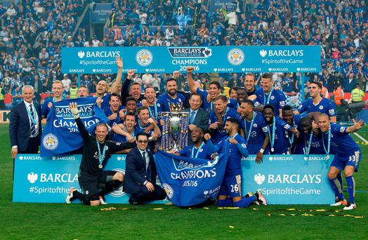 Leicester City celebrate with the trophy after winning the Barclays Premier League. Photo: John Clifton/Reuters