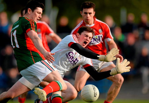 Cork goalkeeper Anthony Casey saves a shot from Mayo's Conor Loftus, during the EirGrid GAA Football Under 21 All-Ireland Championship Final. Photo: Sportsfile