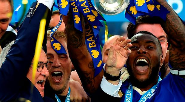 eicester City captain Wes Morgan and manager Claudio Ranieri lift the Premier League Trophy after at The King Power Stadium yesterday. PhotoL Laurence Griffiths/Getty Images