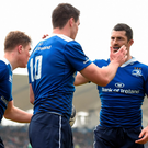 Jonathan Sexton is congratulated by his Leinster team-mates Rob Kearney, right, and Garry Ringrose, left, after scoring his side's first try. Photo: Sportsfile