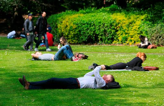 Members of the public enjoying the good weather in St. Stephens Green, Dublin. Photo: Collins