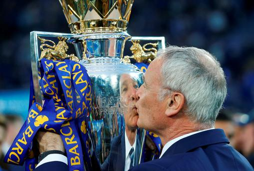 Leicester City manager Claudio Ranieri kisses the trophy as he celebrates winning the Barclays Premier League. Photo: Carl Recine/Reuters