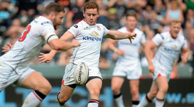 Paddy Jackson hoists an up and under for his team mates to chase. Photo: Sportsfile