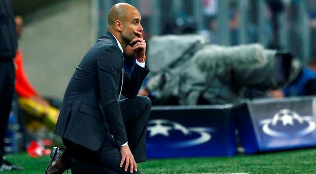 Bayern's head coach Pep Guardiola watches the flow of the game during last Tuesday's Champions League second leg semifinal soccer match against Atletico de Madrid. Photo: Matthias Schrader/AP
