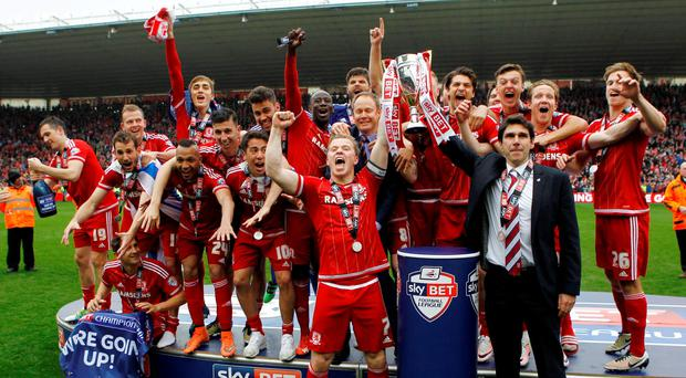 Middlesbrough's Grant Leadbitter and manager Aitor Karanka celebrate with the trophy after being promoted to the Barclays Premier League. Photo: Craig Brough/Reuters