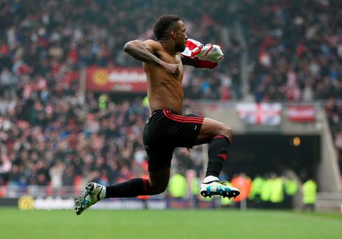 Jermain Defoe celebrates after scoring the third goal for Sunderland during the match against Chelsea. Photo: Russell Cheyne/Reuters