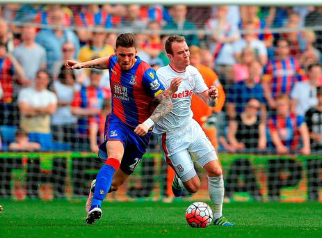 Crystal Palace's Connor Wickham and Stoke City's Charlie Adam (right) battle for the ball. Photo: John Walton/PA
