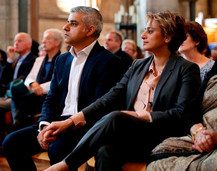 LONDON PRIDE: Sadiq Khan and his wife Saadiya hold hands at the ceremony in Southwark Cathedral. Photo: Yui Mok/PA