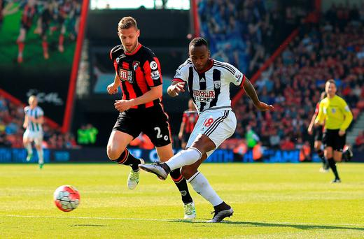 West Brom's Saido Berahino shoots under pressure from Bournemouth's Simon Francis. Photo: Ben Hoskins/Getty Images