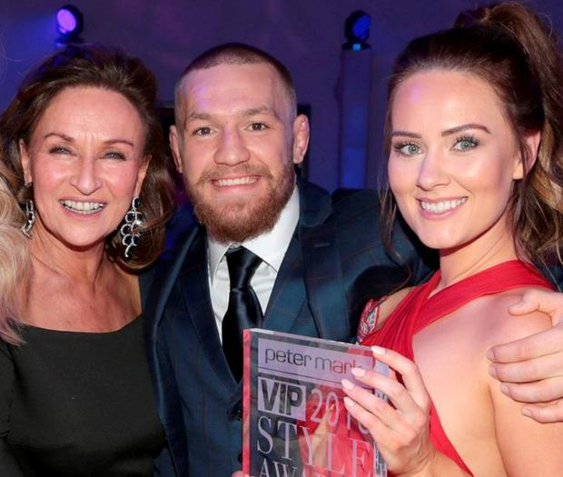 CONFIDENCE: Celia Holman Lee with Conor McGregor and his partner Dee Devlin, who was named Most Stylish Newcomer
