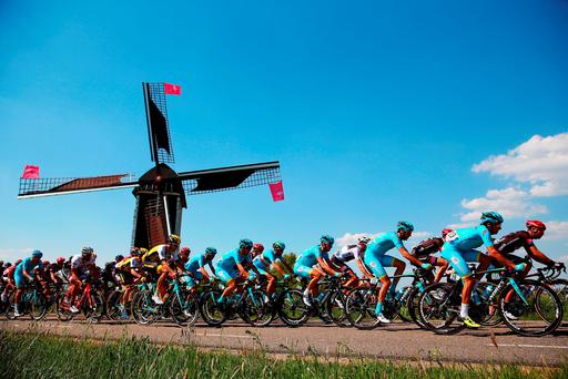 The peloton passes a windmill during stage two of the 2016 Giro d'Italia, a 190km stage from Arnhem to Nijmegen. Photo: Bryn Lennon/Getty Images