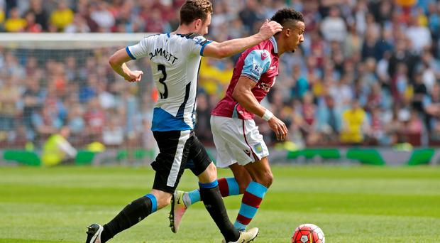 Villa's Scott Sinclair in action with Newcastle's Paul Dummett. Photo: Philip Brown/Reuters
