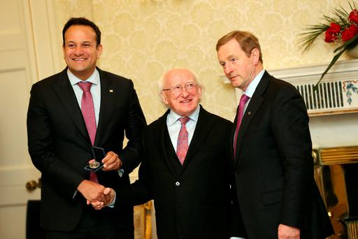 President Michael D Higgins, Taoiseach Enda Kenny and Minister for Social Protection Leo Varadkar at Áras an Uachtaráin.