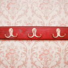 Coat hooks can help clear up potential clutter at the entrance to the home Stock photo: Depositphotos