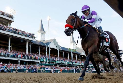 Mario Gutierrez rides Nyquist to victory during the 142nd running of the Kentucky Derby horse race at Churchill Downs